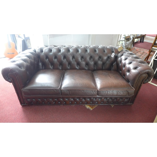 229 - A 20th century brown leather 3 seat Chesterfield sofa...