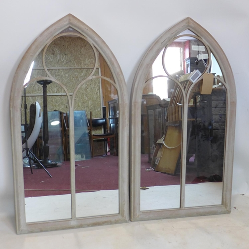 233 - A pair of Gothic style metal arched garden mirrors, 113 x 62cm...