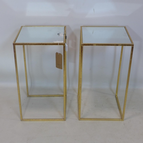 245 - A pair of contemporary square gilt metal occasional tables, with mirrored tops, H.66 W.36 D.36cm (2)...