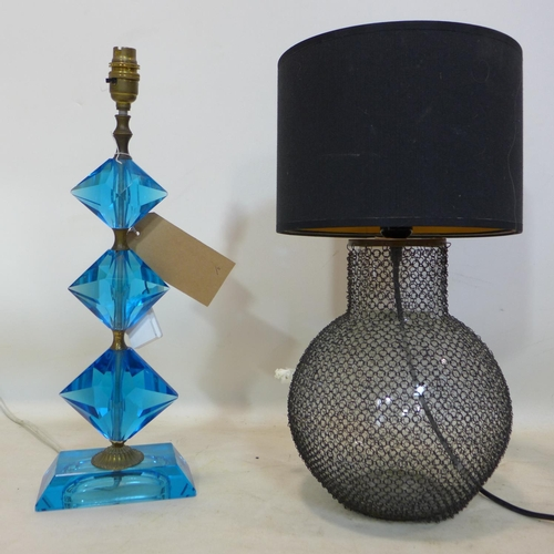 254 - Two lamps: One composed of blue faceted glass, H: 49cm and a glass and mesh example with black shade...