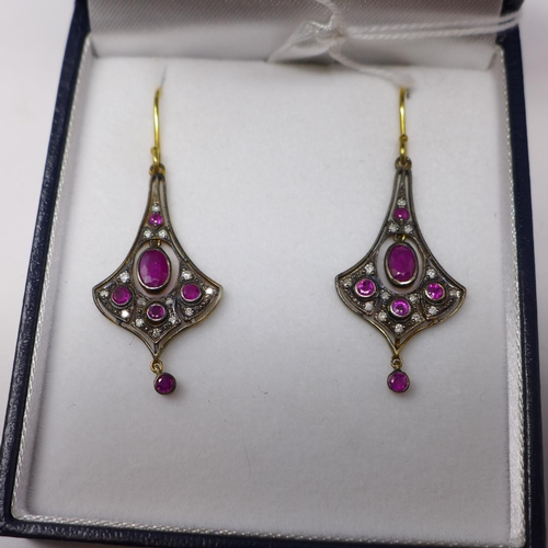 258 - A boxed pair of yellow gold drop earrings set with faceted rubies and brilliant-cut diamonds, Drop: ...