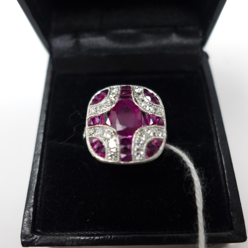 259 - A boxed 18ct white gold Art Deco style, faceted ruby and brilliant-cut diamond ring to diamond-set s...