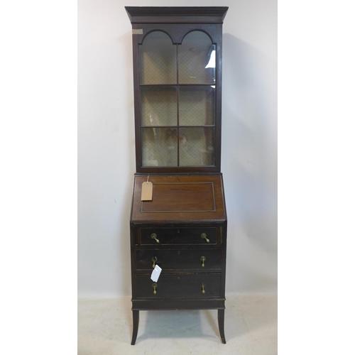 265 - An early 20th century mahogany bureau bookcase, H.193 W.54 D.44cm...
