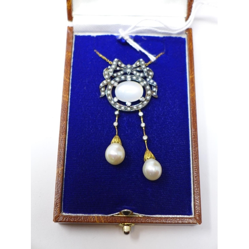266 - A boxed yellow gold necklace set with a central oval moonstone framed by pearls in a bow and ribbon ...