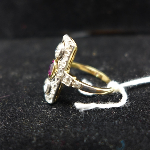 279 - An antique 18ct yellow gold and platinum faceted ruby in collet mounts,  and old-cut diamond panel r...
