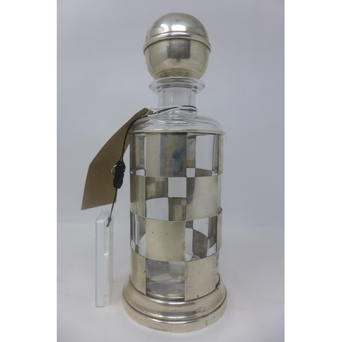 295 - WITHDRAWN- A Gucci silver decanter holder, with glass decanter, stamped 925, Gucci Italy, H.30cm...