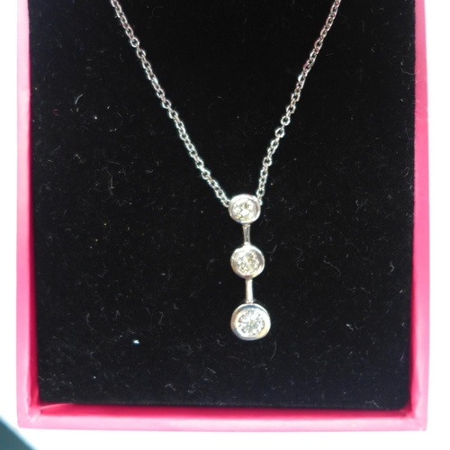 302 - A boxed 18ct white gold pendant on chain, the pendant set with 3 graduated, round brilliant-cut diam...