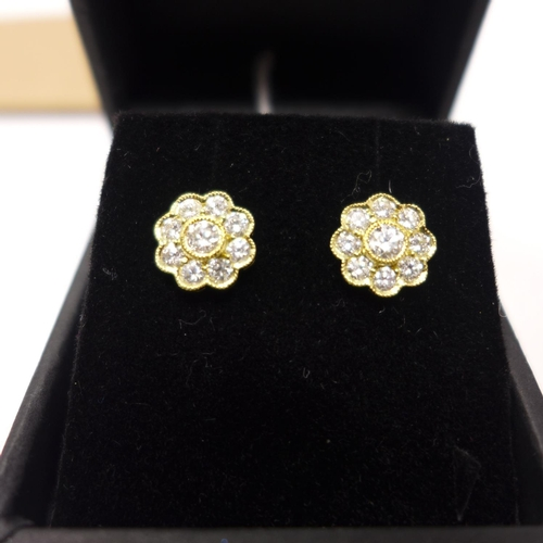 303 - A boxed pair of 18ct yellow gold, brilliant-cut diamond flower-head cluster stud earrings, Dia: 8mm,...