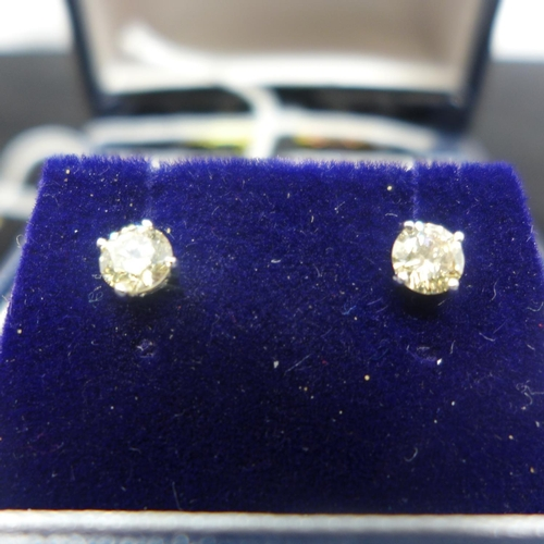 306 - A boxed pair of 18ct white gold and round, brilliant-cut diamond stud earrings (total 0.80 carats) d...