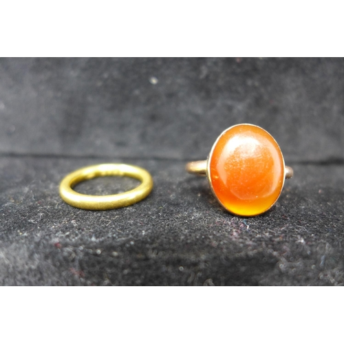 307 - A 22ct yellow gold wedding band, hallmarked, approx. 6.4g, together with a 9ct rose gold ring inset ...