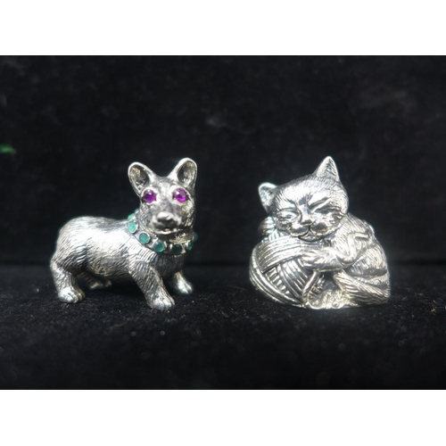 309 - Two sterling silver miniature figurines of a cat with ball of string 2.3 x 2.5cm and a dog with ruby...