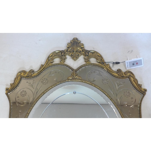 315 - A 20th century wall mirror, gilt frame with Shell finial and scrolling foliate decoration, the oval ...