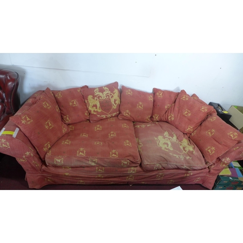 320 - A large sofa purchased from Liberty, London, in two parts, covered in terracotta-coloured cotton uph...