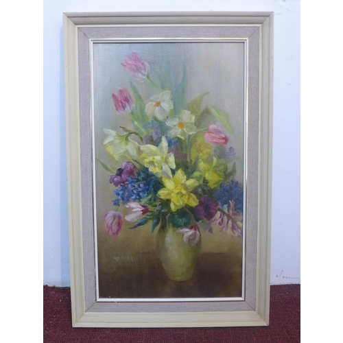 325 - Nin Parker, British, A 20th century framed oil on canvas of a floral still life composition, signed ...