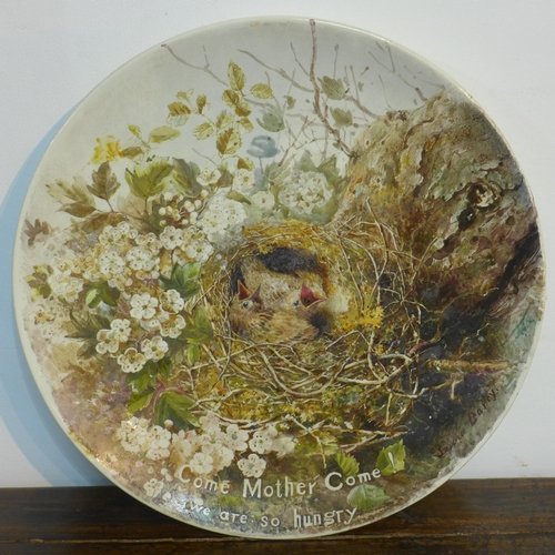 338 - A large early 20th century, Doulton Burslem plate hand-painted with chicks in a nest entitled, 'Come...