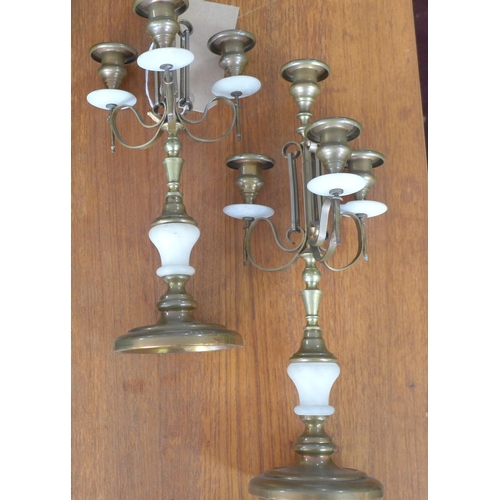 343 - A pair of brass and alabaster candle sticks each with three sconces on circular bases, H: 39cm...