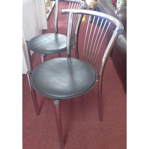 374 - A set of 6 'Calligaris', Italian, chrome dining chairs with circular black leather seats, 1999 model...