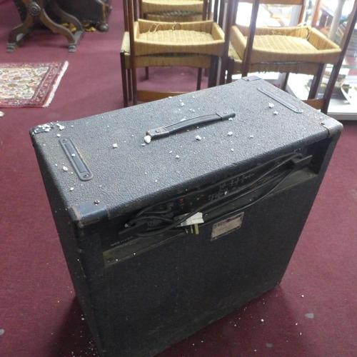 380 - A cased Peavey amplifier, H: 71 x W: 73 x D: 40cm...