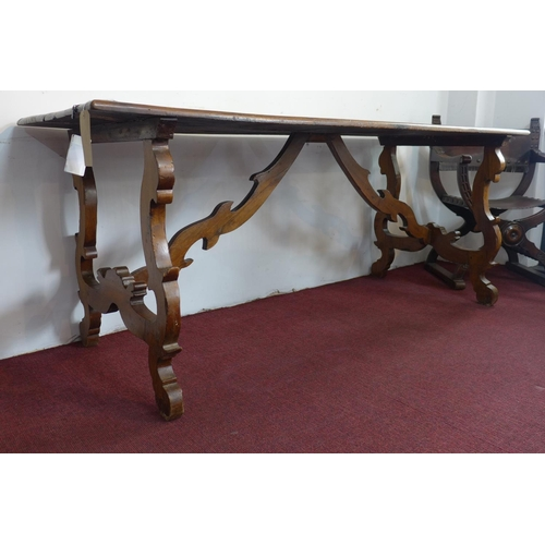 177 - A 17th century walnut trestle table, with carved supports joined by stretcher, H.80 W.200 D.73cm...