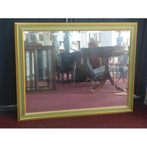 209 - A contemporary wall mirror, with green and gilt frame and bevelled glass plate, 91 x 115cm...
