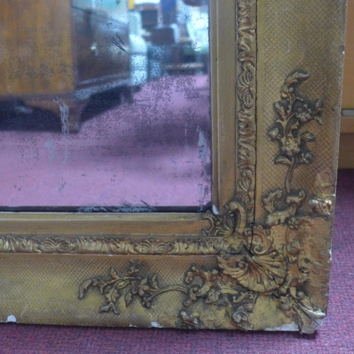 503 - A late 19th / early 20th century giltwood mirror, with floral decoration, chips to frame, 92 x 79cm
