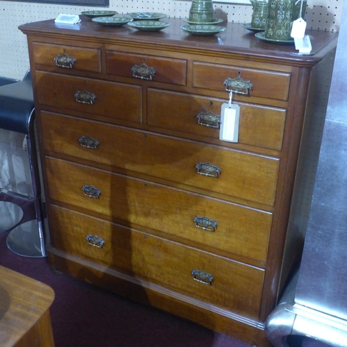 505 - A Victorian Aesthetic movement mahogany chest of drawers, with an arrangement of 8 drawers, raised o...