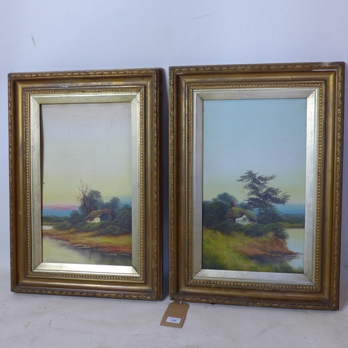 507 - A pair of gilt-framed, 19th century oil on canvasses each depicting a dwelling by a river, each sign...