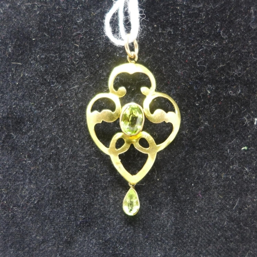 515 - WITHDRAWN- A 9ct yellow gold Art Nouveau pendant set with two faceted peridots to a yellow gold pend...