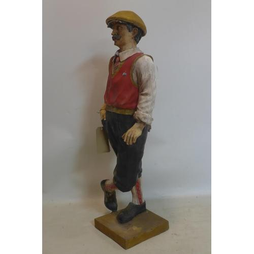 520 - A resin sculpture of a golfer, lacking golf club, H.98cm