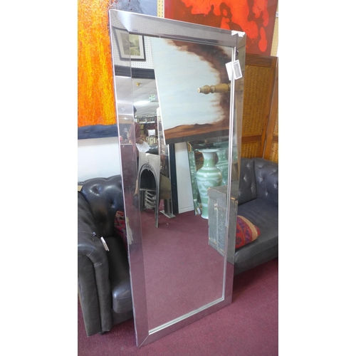 525 - A tall aluminum framed mirror, 175 x 71cm...