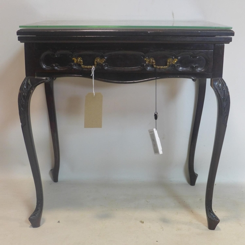528 - A Victorian carved mahogany card table, with single drawer, raised on cabriole legs, H.77 W.70 D.46c...