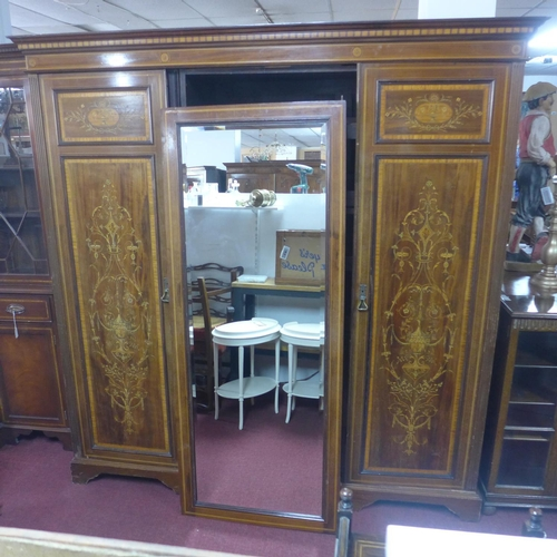 551 - An Edwardian inlaid mahogany triple wardrobe/linen press, with linen drawers, H.210 W.204 D.60cm...