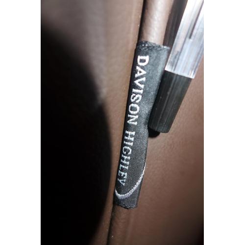 558 - A Davison Highley brown leather sofa, raised on chrome feet