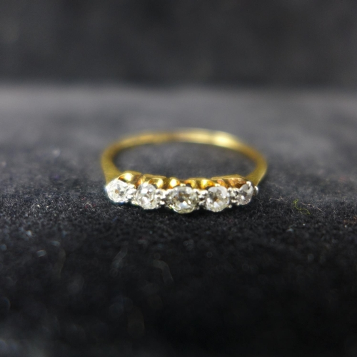 562 - A Victorian 18ct yellow gold and platinum ring set to the centre with five, graduated old-cut diamon...