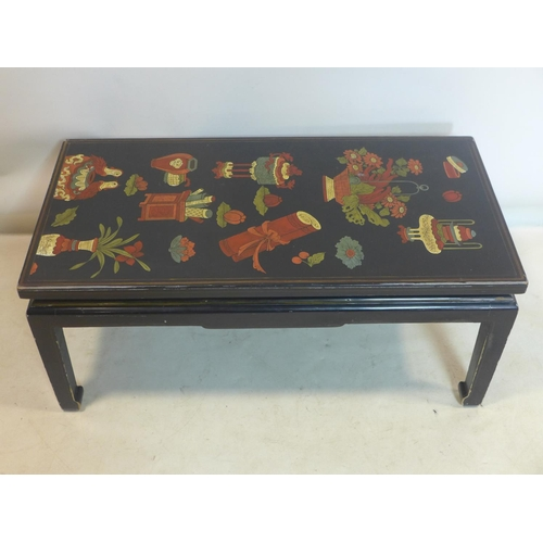 571 - A mid 20th century, Chinese black lacquered coffee table decorated with hand-painted vases and scrol...