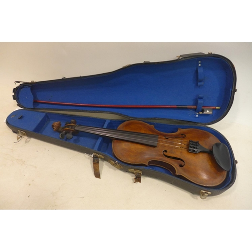 597 - A late 19th/early 20th century violin, with bow and carry case...