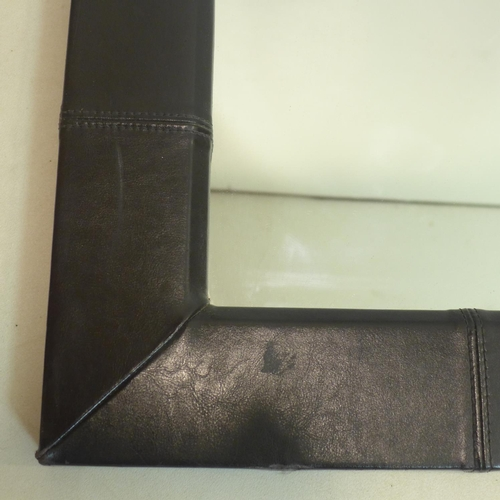 604 - A large contemporary leather clad mirror, 110 x 91cm