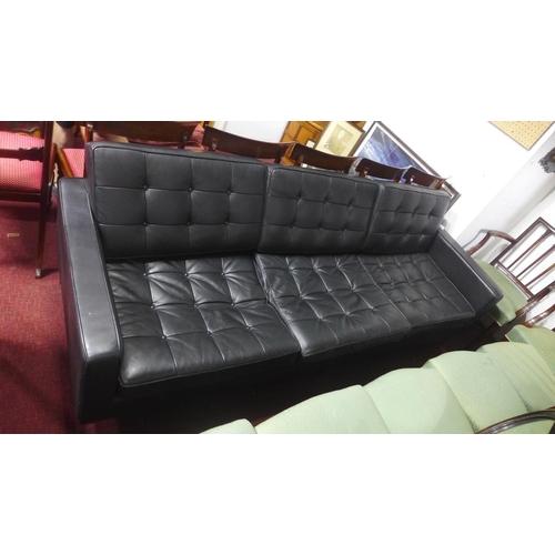 612 - A Florence Knoll style sofa raised on chrome feet