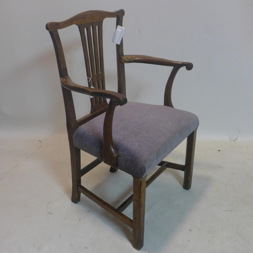 625 - A Georgian oak armchair...