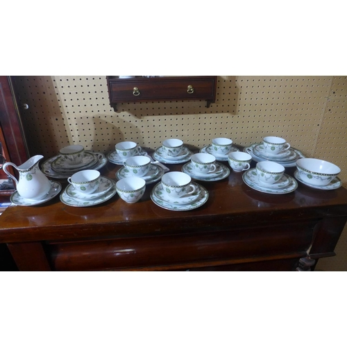 634 - A 19th century porcelain tea set with gold star mark to base...