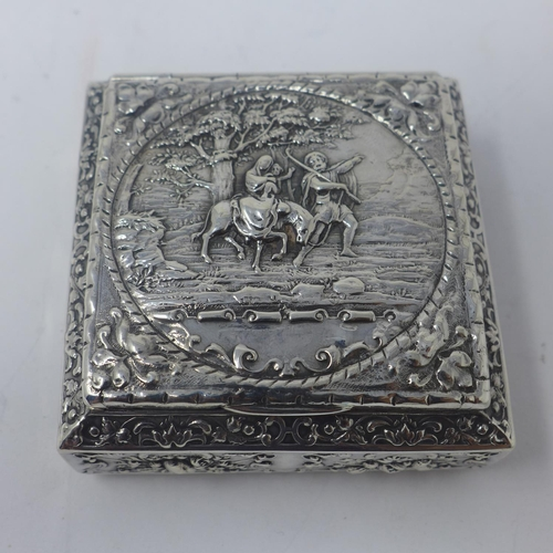 652 - A French silver snuff box, with repousse embossed decoration with vignette of scene from Exodus of E...