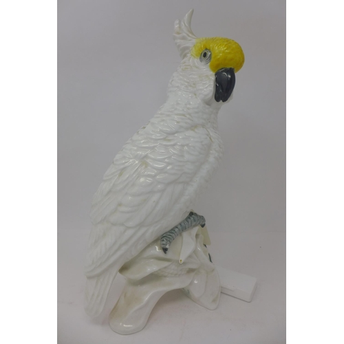 657 - A Crown Staffordshire fine bone china cockatoo, designed and modelled by J.T. Jones, marked to base,...
