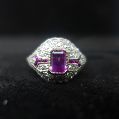 661 - A platinum, diamond and pink sapphire ring in the Art Deco style with ruby detailing, Size: M 1/2, 4...