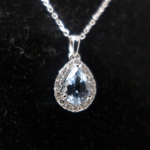 687 - A boxed 18ct white gold pear-shaped aquamarine  and brilliant-cut diamond pendant on an 18ct white g...