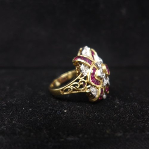 688 - A boxed 14ct yellow gold, faceted ruby and brilliant-cut diamond cluster ring, Size: O, 7.3g...