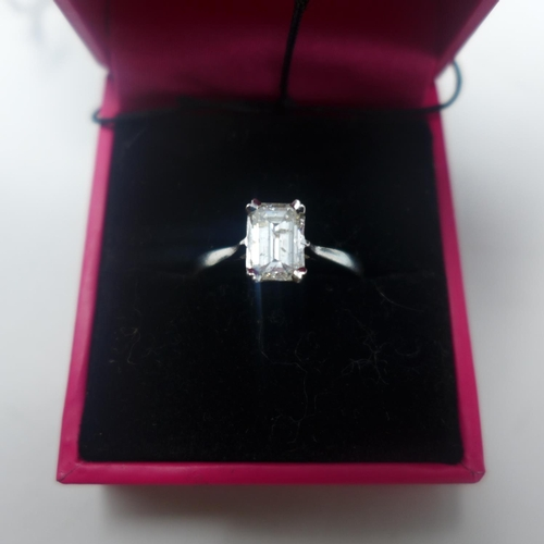 692 - A boxed 18ct white gold emerald-cut diamond solitaire ring of 1.1 carats, size: P, 2.9g...