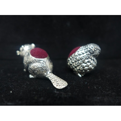706 - Two sterling silver pincushions in the form of a chick 2 x 1.5cm and a beaver with ruby eyes, Gross:...