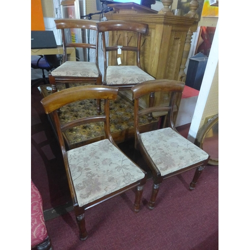 738 - A set of four William IV mahogany dining chairs, with drop-in floral upholstered seats...