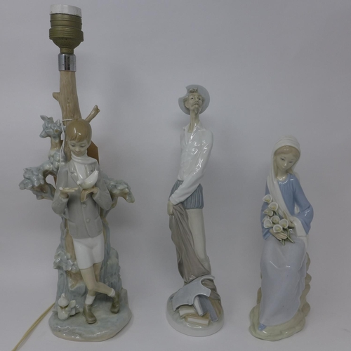 769 - A Lladro figural lamp, modelled as a boy by a tree holding a bird, breaks to bird and hand, H.39cm, ...