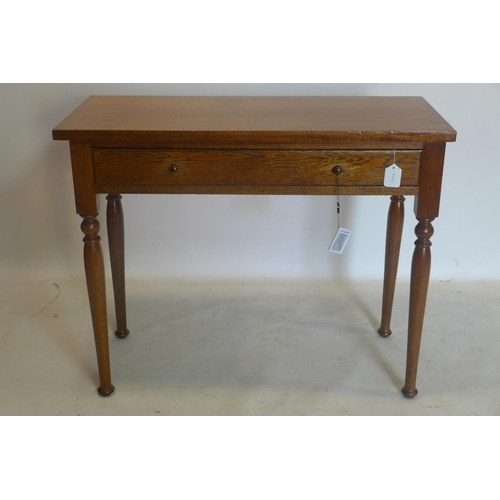 777 - An oak side table with single drawer, raised on turned legs, H.73 W.91 D.40cm...